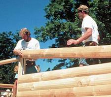 Etape de construction maison en bois massif emplie